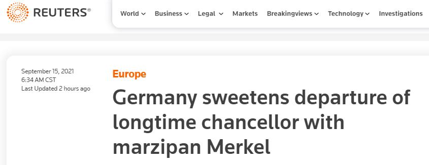 路透社报道截图:德国用默克尔杏仁糖为长期(任职的)总理离任加点甜