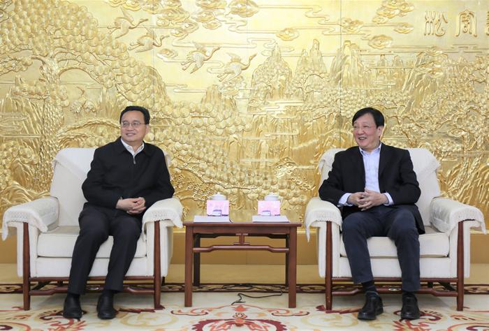 卢进会见梅州市委副书记、市长张爱军一行