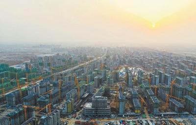 """""""十四五""""时期我国常住人口城镇化率将提高到65%"""
