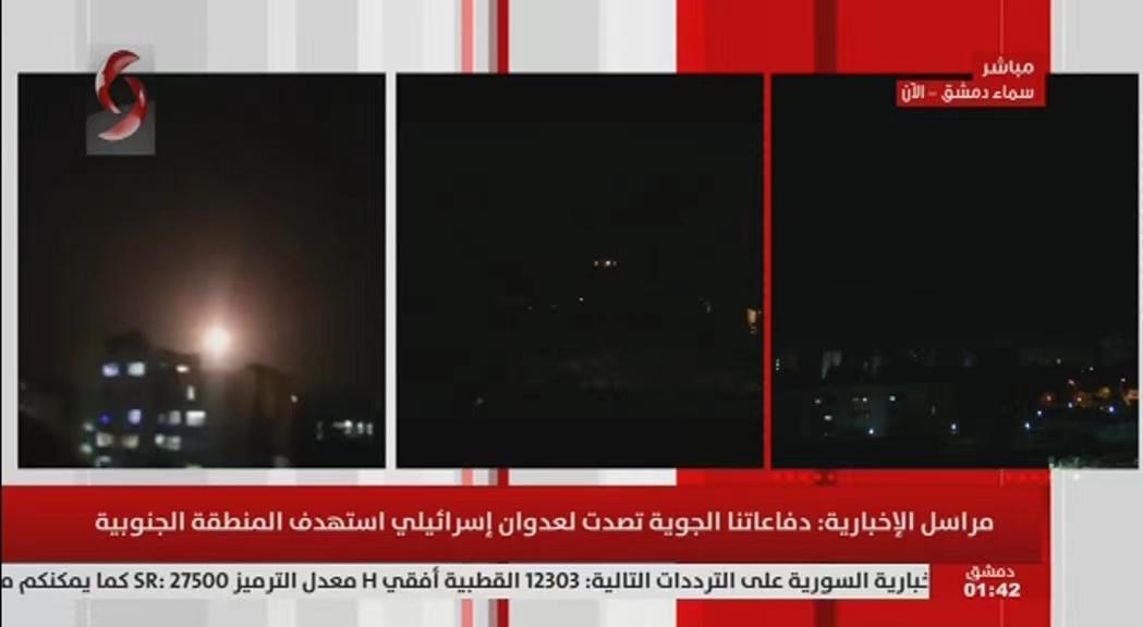 △图片为叙利亚国家电视台报道空袭的画面截图