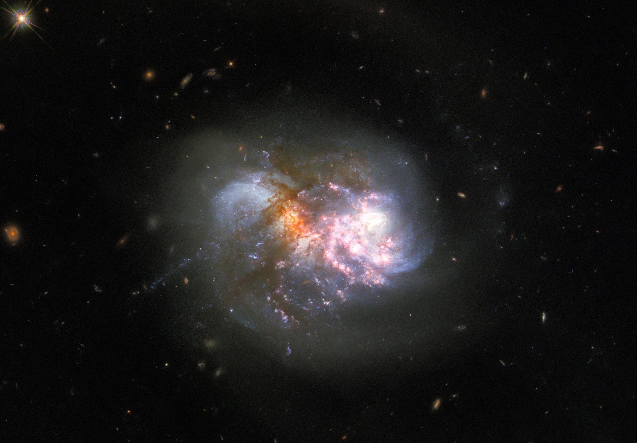"""""""巨人的冲突"""":哈勃望远镜图像展示灾难性的宇宙碰撞"""