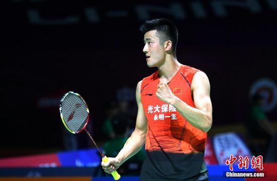 资料图:谌龙在比赛中。中新社记者 吕明 摄