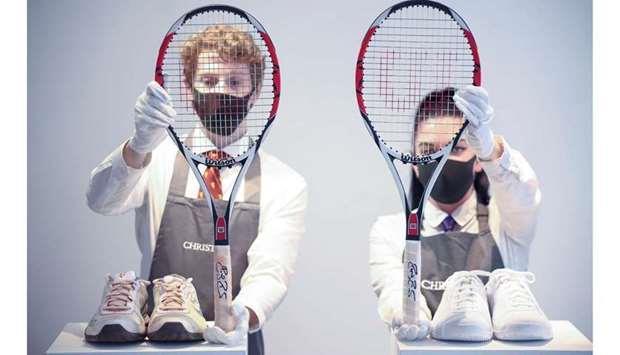 费德勒的球拍、腕带、球鞋都将在两次拍卖会上竞拍