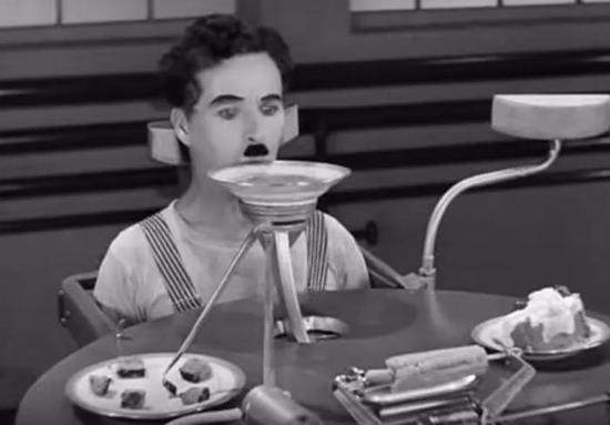 卓别林电影《时兴时代》中,工厂的自动化喂食机器。