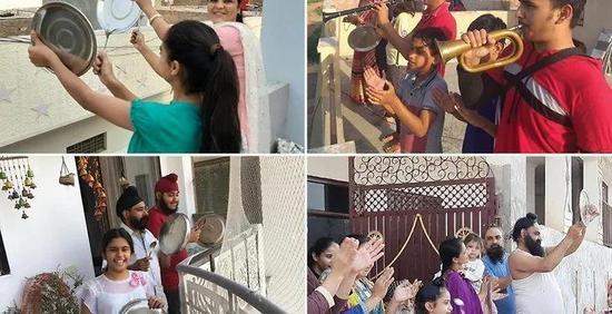 2月23日下午5点,印度人们在窗台敲锣打鼓和鼓掌图片来源:fivetoshine