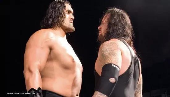 印度职业摔角选手巨人卡里(左)有突出的下巴,这是肢端肥大症造成的。