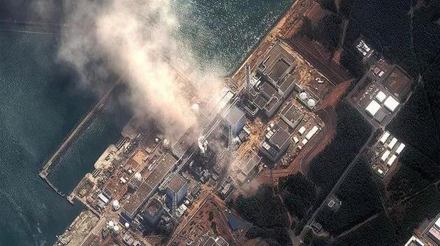 2011年3月14日,福島第一核電站的衛星圖片,此時已經有兩個反應堆發生爆炸