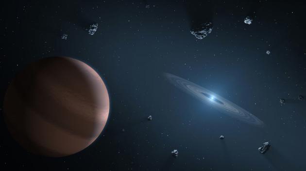 艺术示意图,围绕白矮星运行的一颗系外行星,白矮星周围包裹着一个残骸物质构成的盘状物