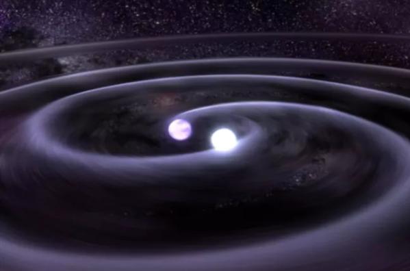 两颗相互环绕并发射引力波的白矮星(艺术想象图)