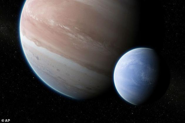 系生手星开普勒-1625b的艺术想象图,它能够拥有一颗卫星。