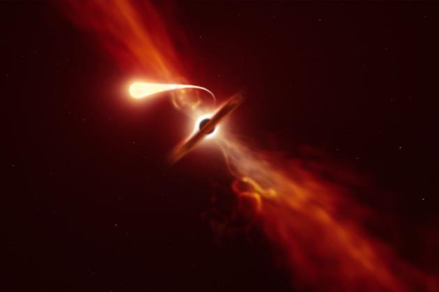 一颗恒星正在被超大质量黑洞的强大引力所破坏(想象图)