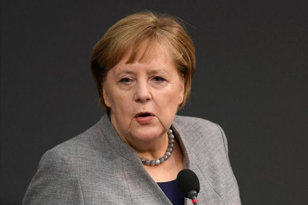 默克尔18日在德国联邦议院 图自路透社