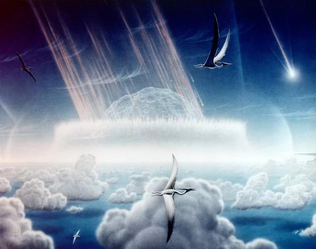 图中是艺术家描绘的0.65亿年前小行星碰撞地球,当时这场灾难导致恐龙灭绝消失