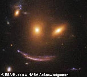 """NASA指出,這張""""微笑的嘴""""是光線效果產生的"""