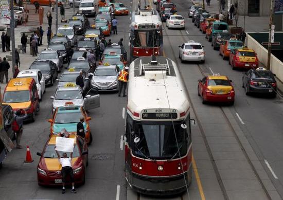 Uber全球遇阻:遭加拿大出租车司机集体抗议