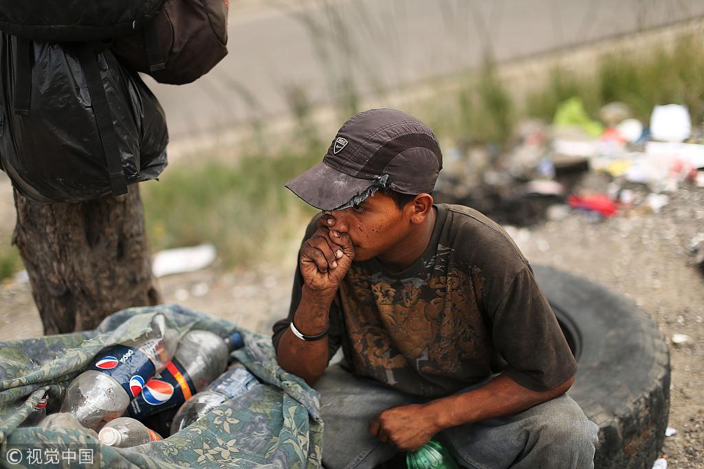 """洪都拉斯是拉美最不发达国家之一,美国上世纪八九十年代在当地发起镇压左翼的""""反游击战"""",引发第一拨大规模难民潮 图源:视觉中国"""