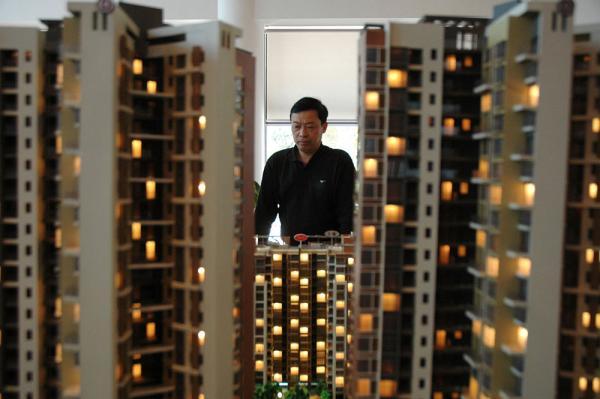 年末房产市场仍然低位运行,有不少企业无法完成全年目标。 视觉中国 图