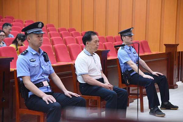 5月30日上午,曹明强在一审庭审现场。原料图