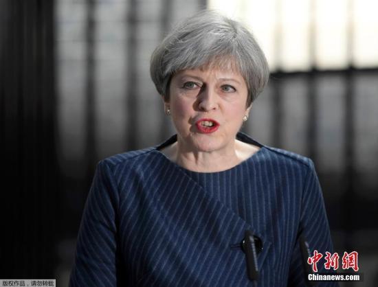 资料图:英国首相特é›・莎Â・梅。