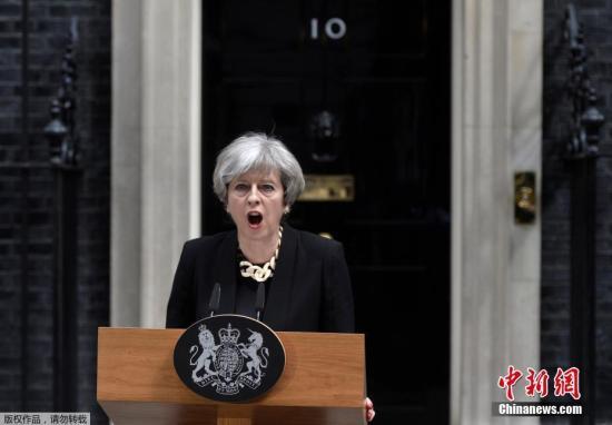 原料图:英国始相特蕾莎·梅。