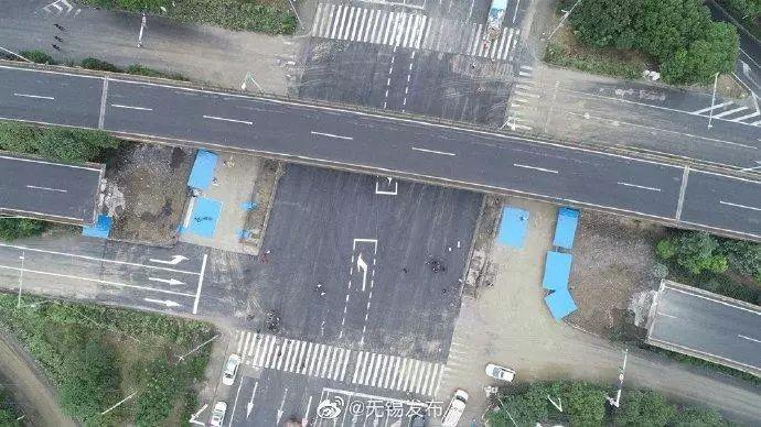 312国道锡港路上跨桥侧翻事发现场地面道路通车 图据@无锡发布