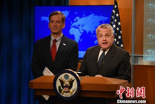 资料图片:美国国务院副国务卿约翰·沙利文(右一)。中新社记者 陈孟统 摄
