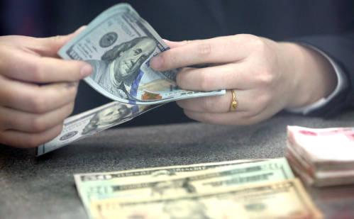 圖爲美元。新華社