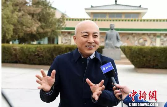 资料图:2019年3月底,王旭东接受中新社记者专访。杨艳敏 摄